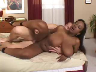 Busty swarthy Sierra rides on a white ramrod and then ends in mouth