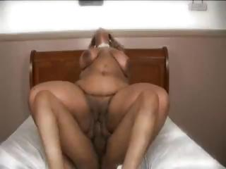 Swarthy BBW shows her large ass, eats some weenie and receives gangbanged
