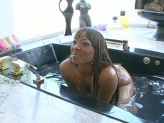If Roxy Reynolds was takin' a baths at your place, there'd be no time for gettin' clean.  This funky and freaky brown sugar chick will entice your dick and have it out of your panties in advance of u can blink.  Next thing u know, that babe's riding that meat pole and working u for your cum!
