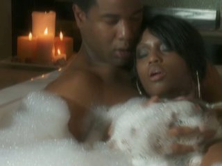 Jade Fire intimate in the bathroom tub with dark dude