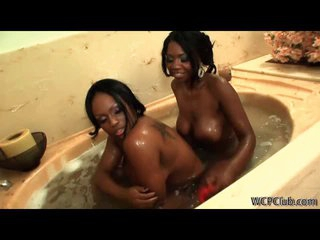 Sexy ebony lesbo duo using toys in the tub