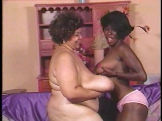 Dark mature with giant boobs has lesbian sex